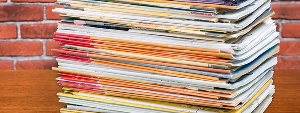 Sending paper catalogs? They're probably in a stack like this, being ignored…